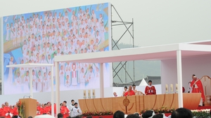 Pope Francis leads the beatification ceremony of 124 Korean martyrs (depicted on screen during the mass