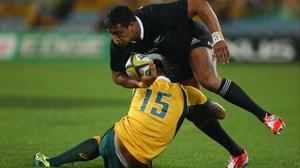 Australia's Israel Folau tackles Julian Savea of the All Blacks