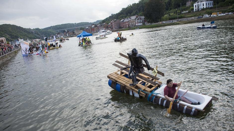 A man takes part in an international bathtub regatta in Belgium