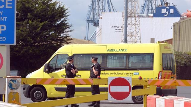 An ambulance van drives into Tilbury Docks in Essex
