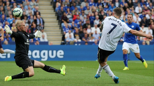 Aiden McGeady curls the ball bast Leicester 'keeper Casper Schmeichel to give Everton the lead