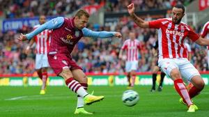 Stoke's Mark Wilson can do little as Andreas Weimann of Aston Villa scores at the Britannia Stadium