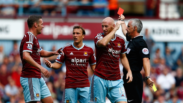 James Collins of West Ham reacts after receiving a red card for his second bookable offence