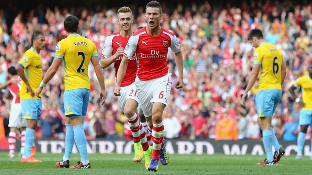 Laurent Koscielny celebrates his goal for Arsenal