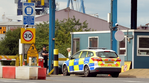 One man died and 34 others were taken to hospital after being found in a container