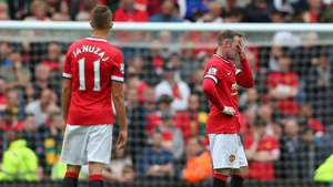 Wayne Rooney holds his head in despair during United's defeat to Swansea