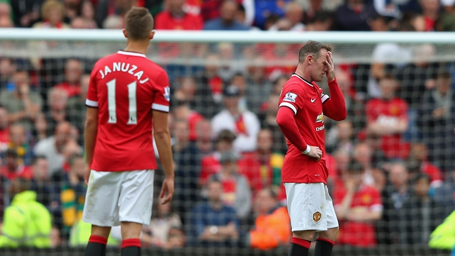 Wayne Rooney holds his head in despair during United's defeat to Swansea