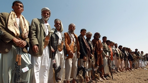 Armed Yemeni men loyal to the Shia Houthi movement attend a tribal gathering