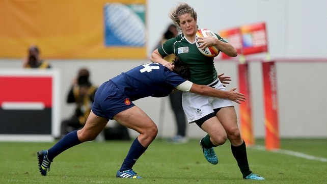 Alison Miller is tackled by France's Shannon Izar