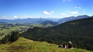 Hikers take a break at the 1,350m high Kappeler Alpe mountain near Pfronten, southern German