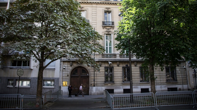 A pedestrian walks past the Saudi Arabian embassy in Paris