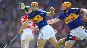 Cork's Daniel Kearney is under pressure to clear the ball as the Tipperary duo of Kieran Bergin and Shane McGrath advance