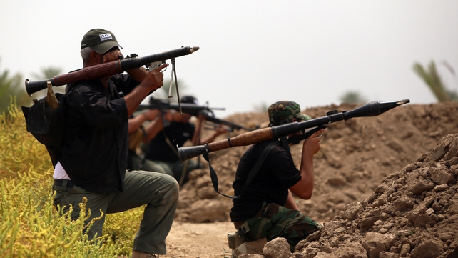 Shiite fighters hold a position as they back the Iraqi army in the fight against Islamic State militants