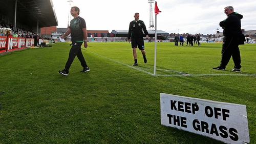 """Shamrock Rover boss looking unhappy walking off the """"unsafe"""" Dalymount Park surface"""