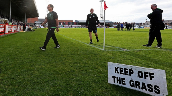 "Shamrock Rover boss looking unhappy walking off the ""unsafe"" Dalymount Park surface"