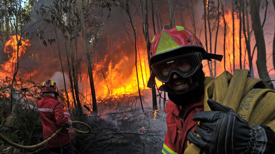Firemen fight a forest fire at Carregal do Sal, in the north of Portugal