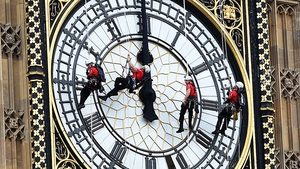 The four faces of the iconic clock tower of Big Ben in London gets a makeover by expert cleaners