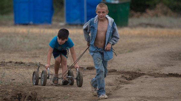 Children from eastern Ukraine, play in a refugee camp near Donetsk