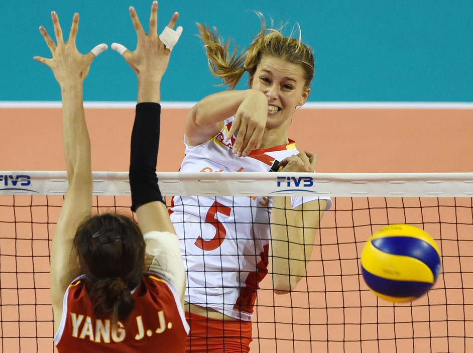 Belgium's Frauke Dirickx spikes the ball past Yang Jinjing of China at the volleyball World Grand Prix in Tokyo