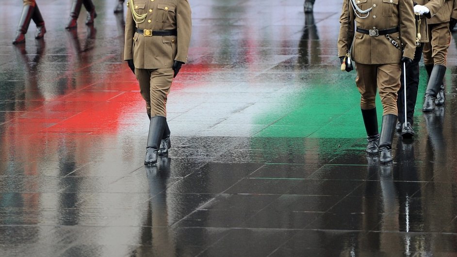 Soldiers march with the Hungarian national flag prior to a military oath ceremony in front of the parliament building at  Kossuth square in Budapest