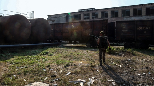 A militia member checks damage after an apparent shelling by the Ukrainian army near Donetsk