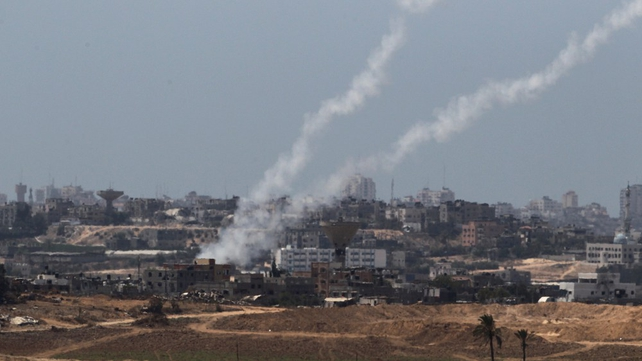 A picture taken from the Israeli side of the Israel-Gaza Border on shows rockets being fired by Palestinian militants from Gaza into Israel