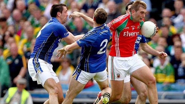 Mayo's Aidan O'Shea with possession of the ball during the 2011 All-Ireland semi-final