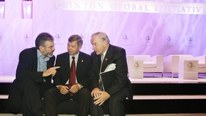 Norway's Prime Minister Kjell Magne Bondevik (C) speaks with Gerry Adams (L) and Albert Reynolds after attending the session 'Bringing and end to War' at the Clinton Global Initiative forum in 2005