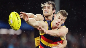 Ben Griffiths of the Richmond Tigers competes with Josh Jenkins of the Adelaide Crows in their AFL encounter
