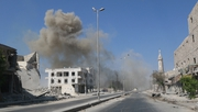 Smoke rises following a reported barrel bomb attack by Syrian government forces in the northern city of Aleppo