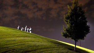 National Guardsmen watch from a small hill near where demonstrators protest the shooting death of Michael Brown in Ferguson, Missouri