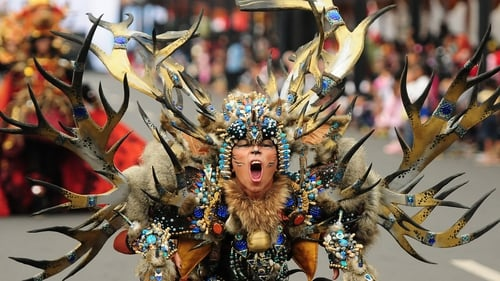 A model wears a Wild Deer costume in the children's carnival during the 13th Jember Fashion Carnival in Indonesia