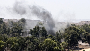A picture taken from the southern Israeli border with Gaza shows smoke rising from the remains of a mortar fired by Palestinian militants into Israel
