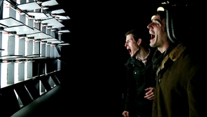 Festivalgoers interact with a voice activated display during the Lux Light Festival in New Zealand