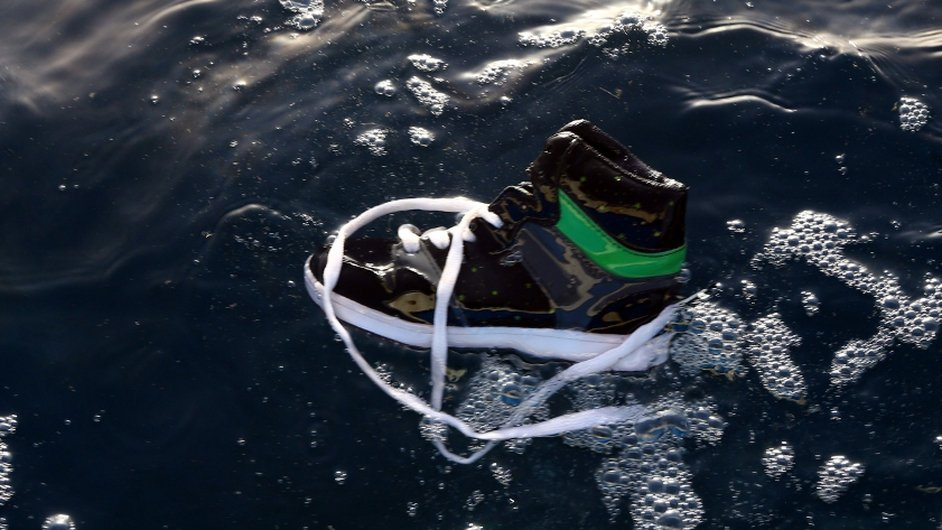 A shoe belonging to an illegal immigrant floats on the water after a boat carrying migrants sinks