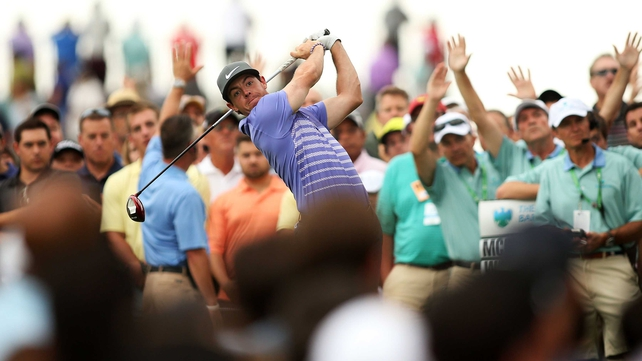 Rory McIlroy plays his shot from the 13th tee during the second round of The Barclays