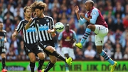 Fabian Delph of Aston Villa challenges Fabricio Coloccini of Newcastle United
