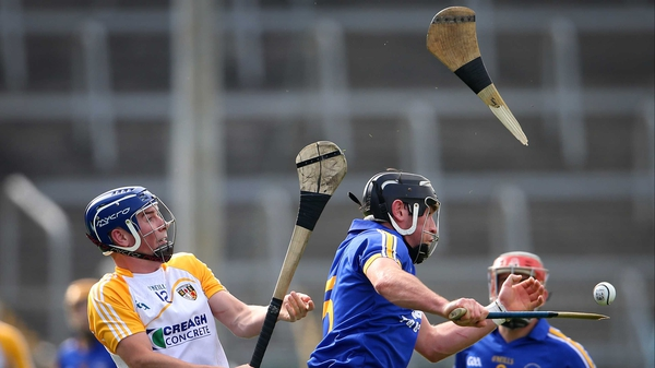 Antrim's Darragh McGuinness breaks the hurley of Clare's Gearoid O'Connell