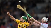 Galway's John Hanbury (R) contests a ball with Wexford's Conor McDonald