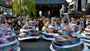 Participants in costumes perform during the 33rd Asakusa Samba