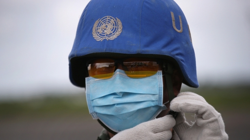 A Chinese UN soldier prepares a truckload of Ebola relief aid from United Nations Children's Fund