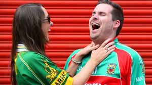 Kerry supporter Julie Brick from Tralee and Mayo supporter Damien Ruddy from Glenamoy joke around before the game