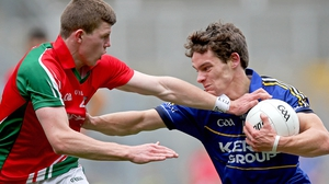 Tomas O Sé of Kerry with Conor Kilkenny of Mayo face off in the minor semi-final