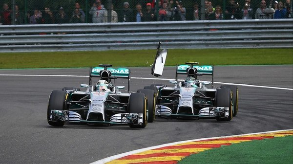 Team-mates Lewis Hamilton (L) and and Nico Rosberg collided in just the second lap