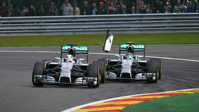 Lewis Hamilton (left) and Nico Rosberg (right) collided in Belgium