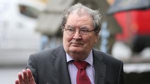 Former SDLP leader John Hume arrives for the funeral