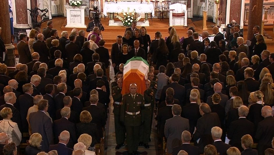 The coffin carrying Mr Reynolds's remains is carried from the church