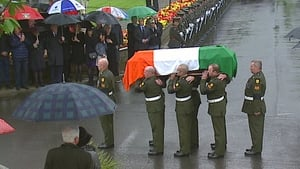 Mr Reynolds's coffin is carried by members of the Defence Forces