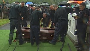 The coffin is lowered to Mr Reynolds's final resting place