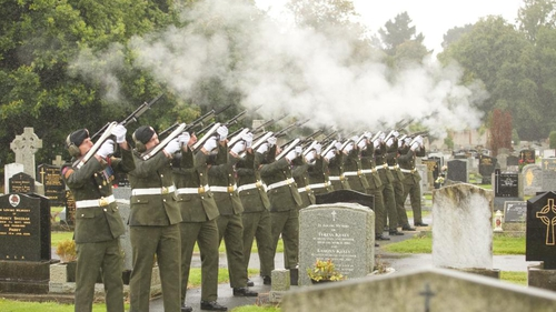 Members of the Defence Forces take part in a military salute at Mr Reynolds's graveside (Pic: Merrion Street)